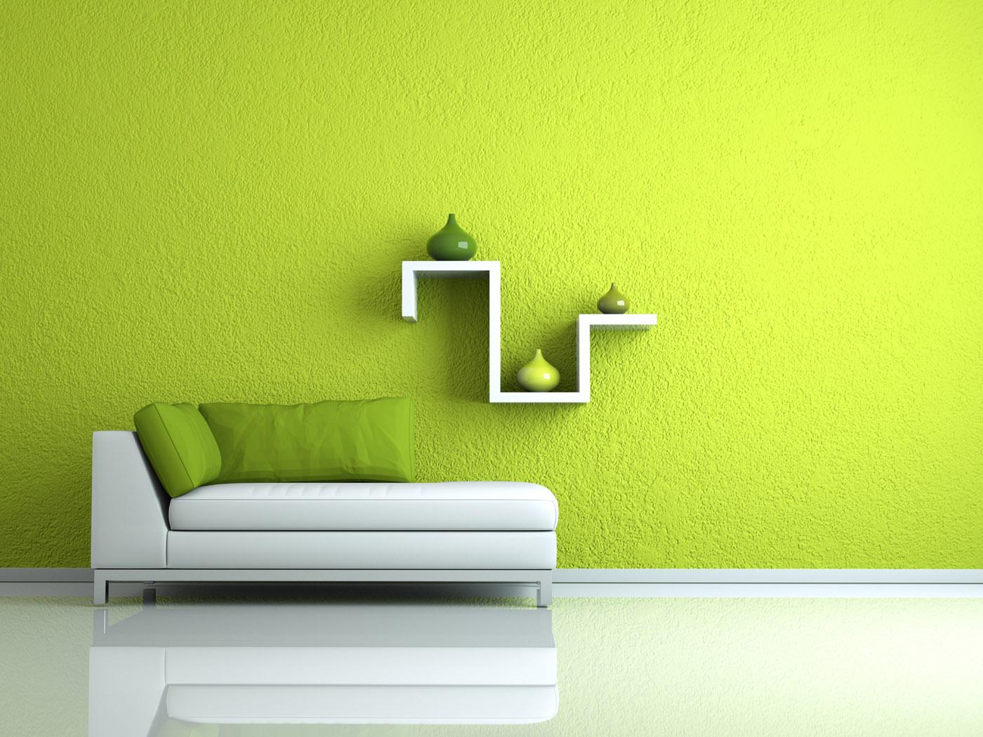 Grünes Sofa vor grüner Wand